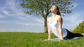 Young attractive woman doing yoga in beautiful natural surroundings Royalty Free Stock Images
