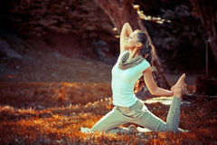 Young attractive woman doing yoga Royalty Free Stock Photos