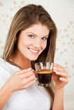 Young attractive  woman drinking coffee Royalty Free Stock Photography