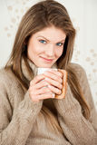 Young attractive  woman drinking coffee Stock Photography