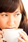 Young attractive woman drinking coffee Stock Photos
