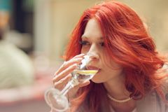 Young attractive woman drinking a glass of water in a street cafe royalty free stock images