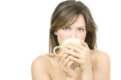 Young attractive  woman drinking tea Royalty Free Stock Images