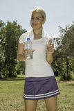 Young attractive woman drinking water. Portrait of young attractive woman drinking water royalty free stock photography