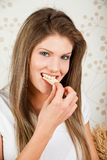 Young attractive woman eating chips Royalty Free Stock Photography