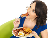 Young Attractive Woman Eating a Full English Breakfast Stock Image