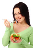 Young attractive woman eats vegetable salad Stock Image