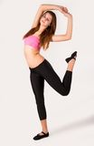 Pretty girl doing fitness exercise Stock Photo