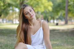 Young attractive woman enjoying nature in park. Stock Photos