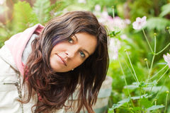 Young attractive woman enjoys beautiful garden Royalty Free Stock Photography