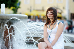 Young attractive woman by a fountain Royalty Free Stock Photography