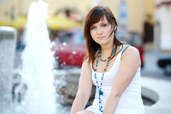 Young attractive woman by a fountain royalty free stock images