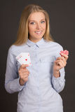 Young attractive woman with four aces and poker chips over grey Stock Photography