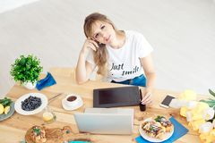 Young attractive woman freelancer sitting front laptop computer drawing on graphic tablet, business woman sitting at the royalty free stock photo