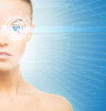Young and attractive woman from future with the laser hologram Stock Photography