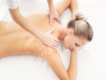 Young attractive woman getting massaging treatment Stock Photos