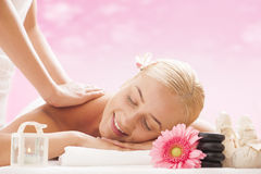 Young attractive woman getting massaging treatment Stock Image