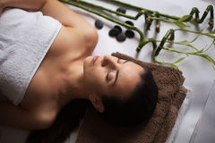Young attractive woman getting spa treatment over white background Royalty Free Stock Photo