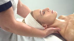 Young attractive woman getting spa treatment over white background stock footage