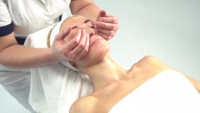 Young attractive woman getting spa treatment over white background stock video