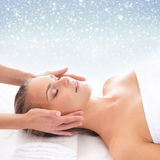 Young attractive woman getting spa treatment on the snow stock photo