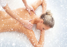 Young attractive woman getting spa treatment on the snow Stock Image