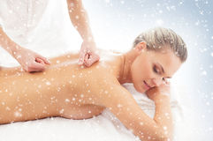 Young attractive woman getting spa treatment on the snow Royalty Free Stock Image
