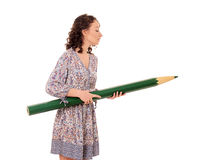 Young attractive woman with giant green pencil Stock Photography