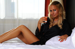 Young attractive woman with glass of juice Stock Photography