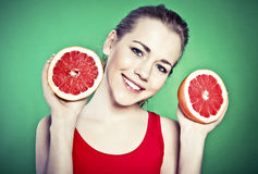 young attractive woman with grapefruit Royalty Free Stock Photo