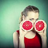 Young attractive woman with grapefruit Stock Photo