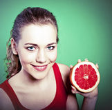 Young attractive woman with grapefruit Stock Image