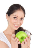 Young attractive woman with green apple Royalty Free Stock Photography