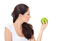 Young attractive woman with green apple Stock Photography