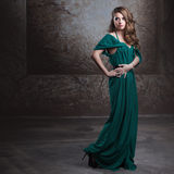 Young attractive woman in green dress Royalty Free Stock Image