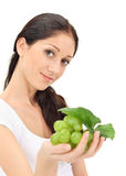 Young attractive woman with green grape cluster Stock Image