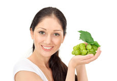 Young attractive woman with green grape cluster Stock Photography