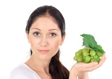 Young attractive woman with green grape cluster Royalty Free Stock Photo