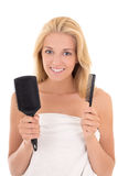 Young attractive woman with hairbrushes on white background Royalty Free Stock Images