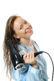 Young attractive woman with hairdryer Royalty Free Stock Image