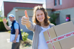 Young attractive woman happy to receive parcel Royalty Free Stock Photography