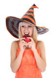 Young attractive woman in hat biting red apple Royalty Free Stock Images