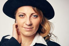Young attractive woman in a hat. Portrait of a young attractive woman in a hat Stock Photos