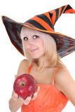 Young attractive woman in hat with red apple Stock Images