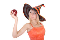 Young attractive woman in hat with red apple Royalty Free Stock Photos