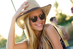 Young attractive woman with hat on a summer day. Stock Photos