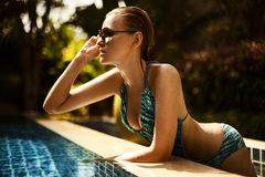 Young attractive woman having good time in swimming Stock Photography