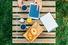 Young And Attractive Woman Having Morning Breakfast In Green Garden Stock Photography