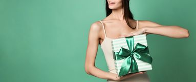 Young attractive woman having a present royalty free stock images