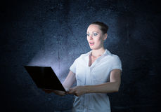 Young Attractive Woman Holding A Laptop Stock Image